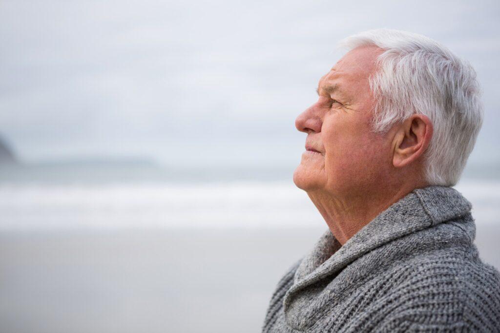 Thoughtful senior man standing